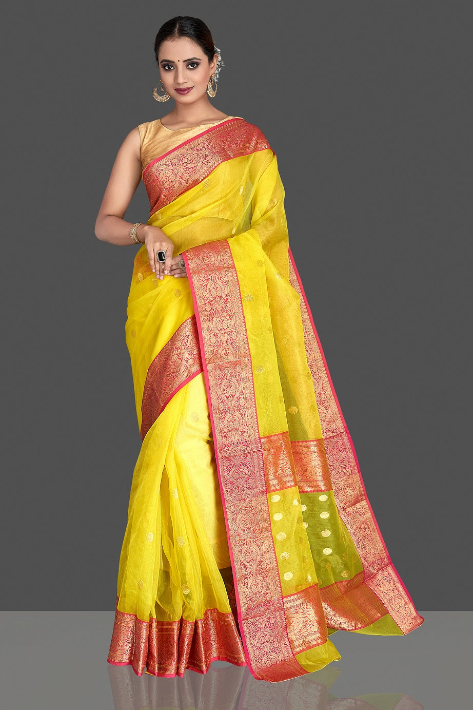 Buy gorgeous light yellow chanderi silk saree online in USA with pink zari border. Buy gorgeous Indian designer sarees, pure handwoven sarees, zari work sarees, Maheshwari sarees, chanderi saris in USA from Pure Elegance Indian fashion store.-full view