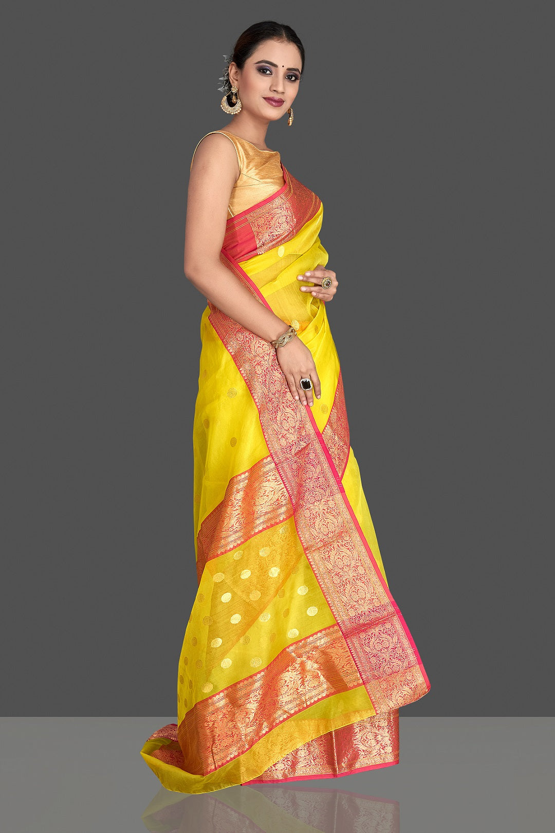 Buy gorgeous light yellow chanderi silk saree online in USA with pink zari border. Buy gorgeous Indian designer sarees, pure handwoven sarees, zari work sarees, Maheshwari sarees, chanderi saris in USA from Pure Elegance Indian fashion store.-side