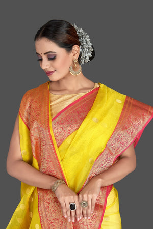 Buy gorgeous light yellow chanderi silk saree online in USA with pink zari border. Buy gorgeous Indian designer sarees, pure handwoven sarees, zari work sarees, Maheshwari sarees, chanderi saris in USA from Pure Elegance Indian fashion store.-front