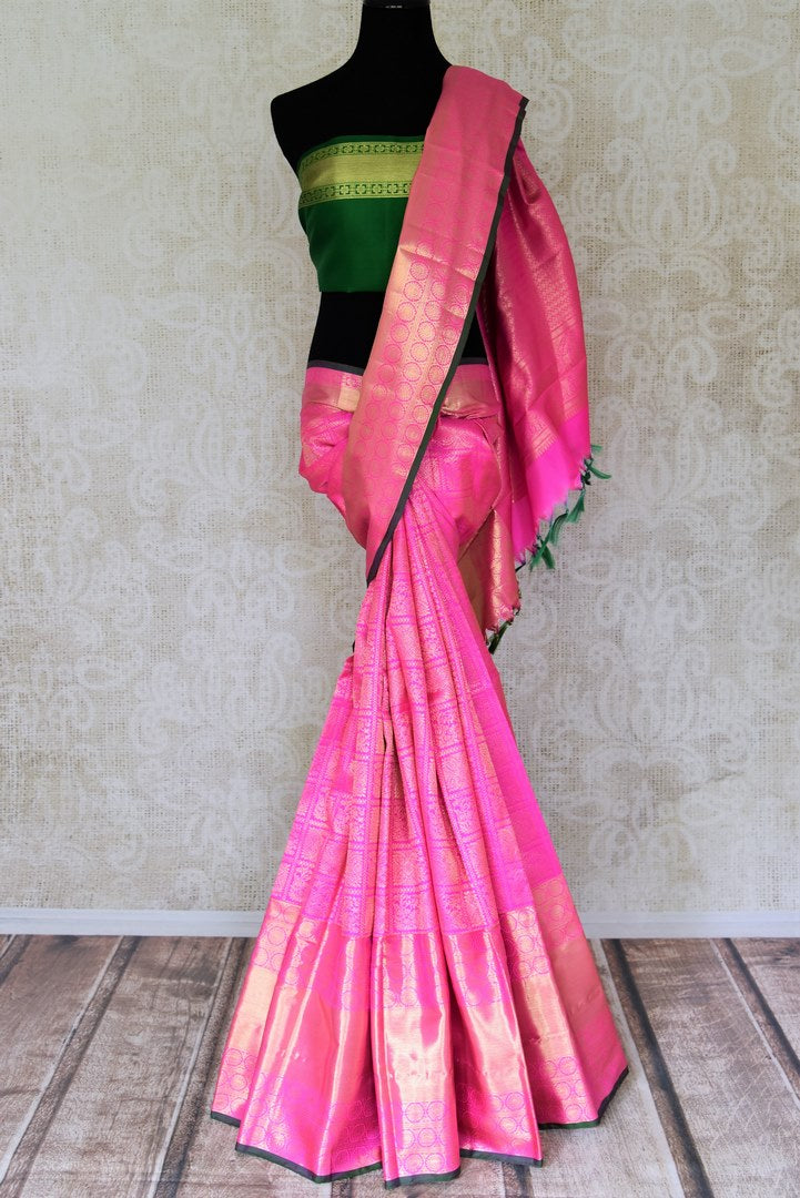 Shop exquisite light pink Kanjeevaram saree online in USA with golden zari work. Look beautiful on special occasions with beautiful Kanjivaram silk sarees, pure silk saris, soft silk sarees, handwoven silk sarees in from Pure Elegance Indian saree store in USA.-full view
