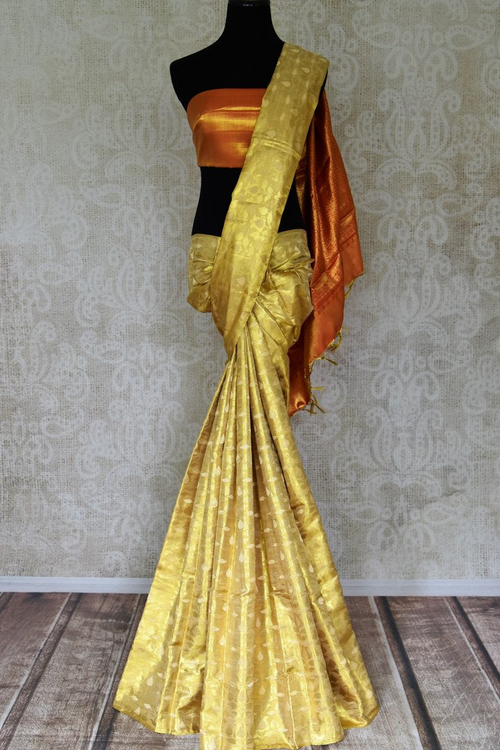Buy beautiful cream and golden Kanjeevaram sari online in USA with red zari pallu. Look beautiful on special occasions with beautiful Kanjivaram silk sarees, pure silk saris, soft silk sarees, handwoven silk sarees in from Pure Elegance Indian saree store in USA.-full view