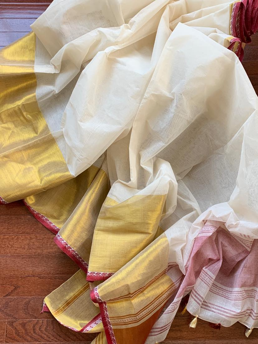 Buy stunning white cotton saree online in USA with broad golden border. Shop beautiful handowoven saris, chanderi sarees, Maheshwari sarees, pure silk sarees, Banarasi sarees online in USA from Pure Elegance Indian fashion store.-flatlay