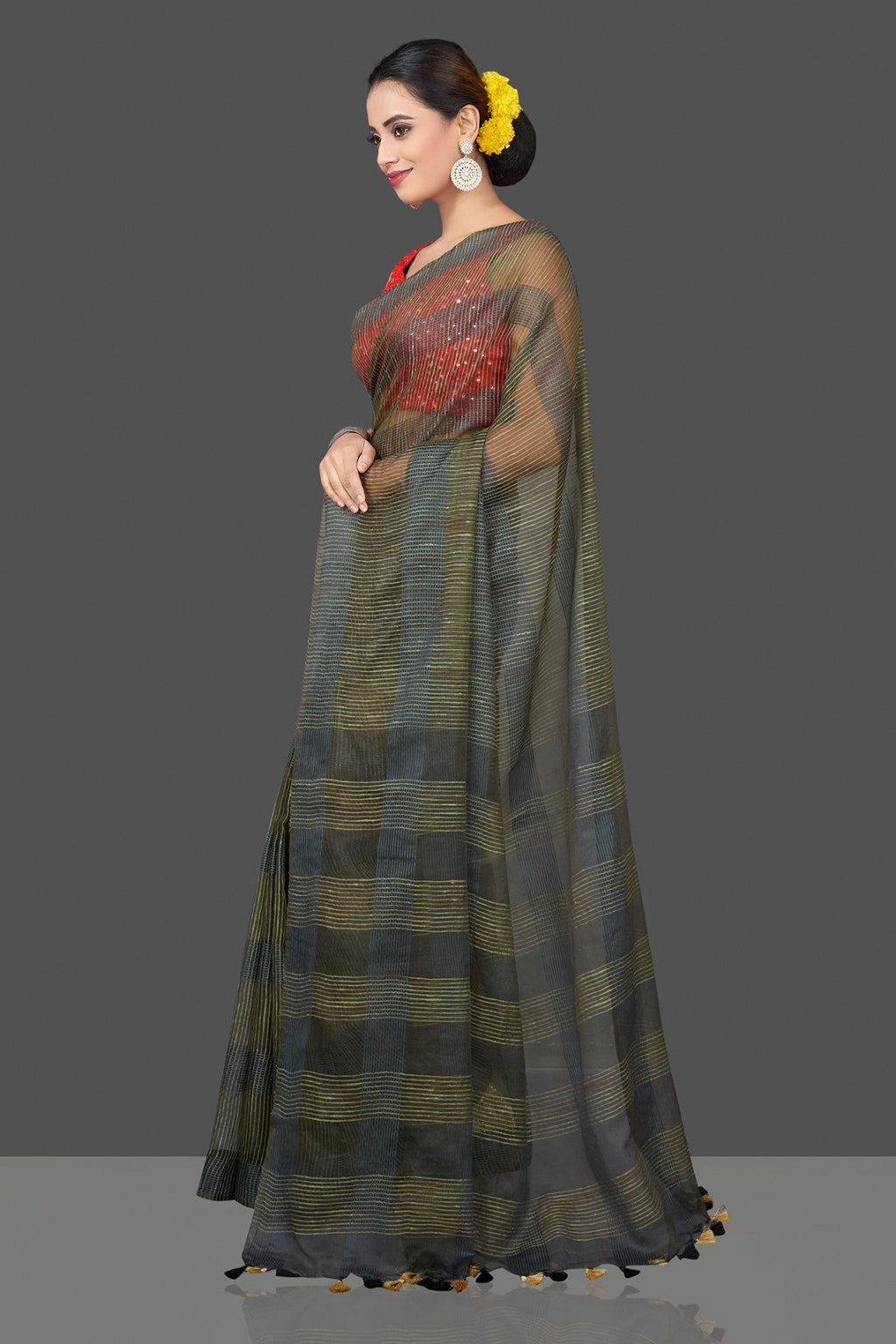 Shop stunning olive green and grey tussar sari online in USA with organza pallu and red  mirror work sari blouse. Shop handowoven sarees, designer saree blouses, embroidered sarees, designer sarees, pure silk sarees, tussar saris online in USA from Pure Elegance Indian saree store.-pallu