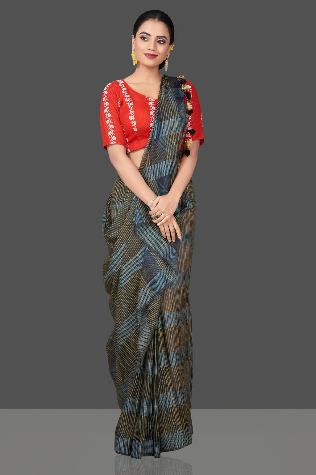 Shop gorgeous black and blue tussar sari online in USA with organza pallu and red embroidered sari blouse. Shop handowoven sarees, designer saree blouses, embroidered sarees, designer sarees, pure silk sarees, tussar saris online in USA from Pure Elegance Indian saree store.-full view