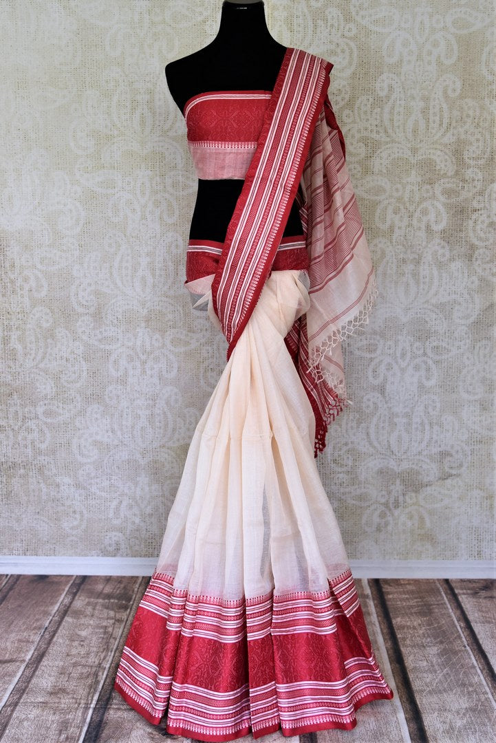 Shop stunning cream Bengal cotton saree online in USA with red border. Look beautiful on special occasions with exquisite Jamdani sarees, cotton sarees, soft silk sarees, handwoven sarees in from Pure Elegance Indian saree store in USA.-full view