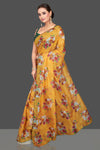 Buy stunning yellow floral organza saree online in USA with green mirror work sari blouse. Look glamorous at parties and weddings in stunning designer sarees, embroidered sareees, fancy sarees, Bollywood sarees from Pure Elegance Indian saree store in USA.-full view