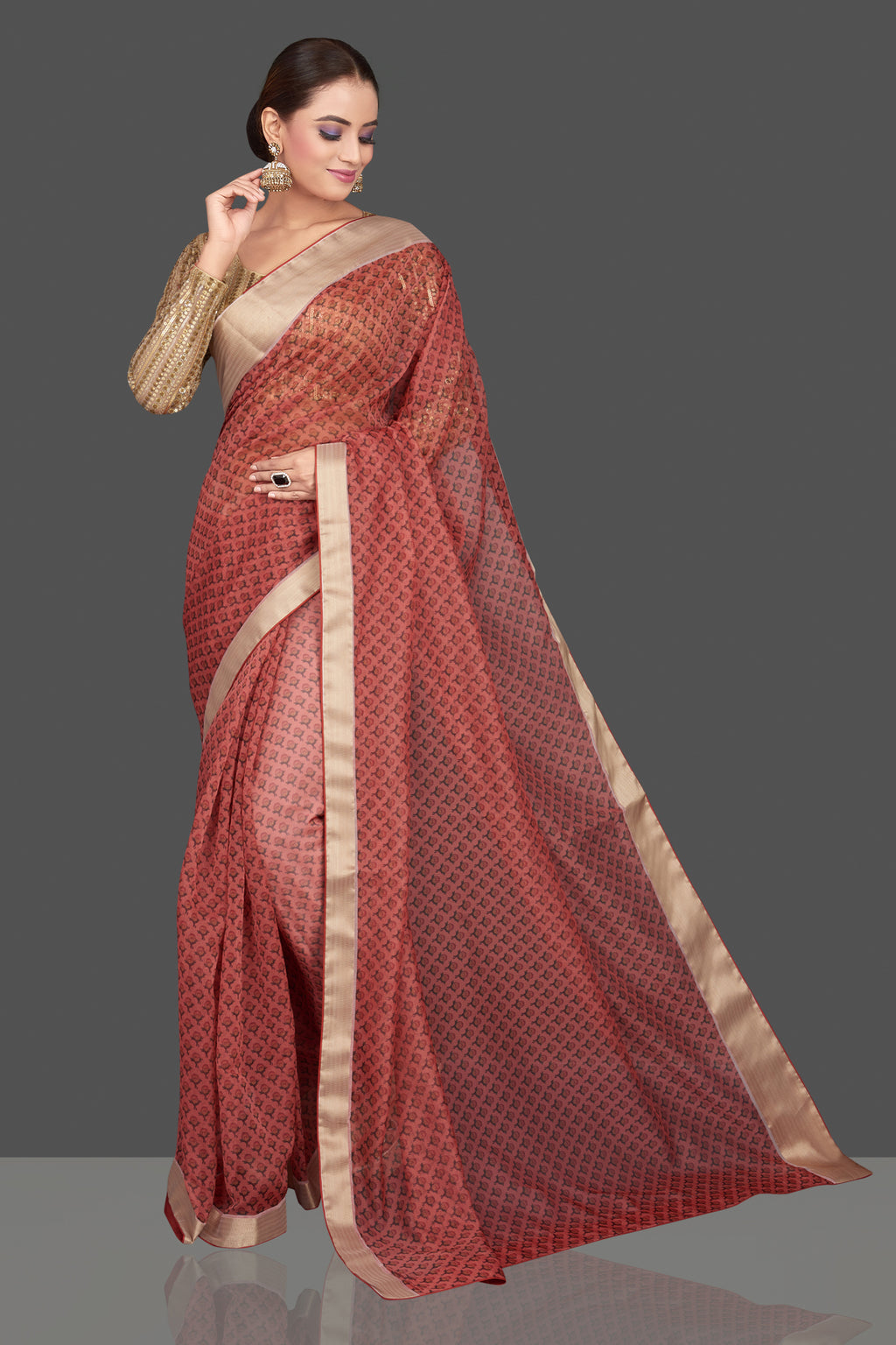 Buy red printed organza sari online in USA with golden sari blouse. Look glamorous at parties and weddings in stunning designer sarees, embroidered sareees, fancy sarees, Bollywood sarees from Pure Elegance Indian saree store in USA.-full view