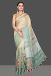 Shop stunning cream and mint green floral linen sari online in USA. Look glamorous at parties and weddings in stunning designer sarees, embroidered sareees, fancy sarees, Bollywood sarees from Pure Elegance Indian saree store in USA.-full view