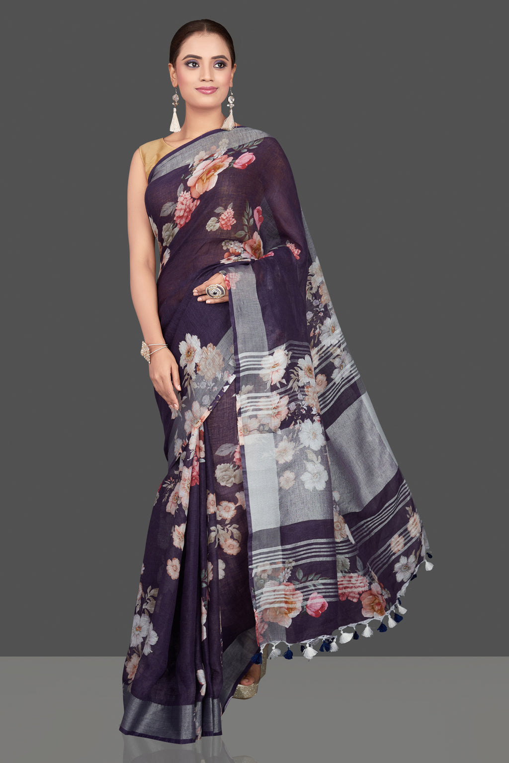 Buy stunning purple floral linen sari online in USA with silver border. Look glamorous at parties and weddings in stunning designer sarees, embroidered sarees, fancy sarees, Bollywood sarees, linen sarees from Pure Elegance Indian saree store in USA.-full view