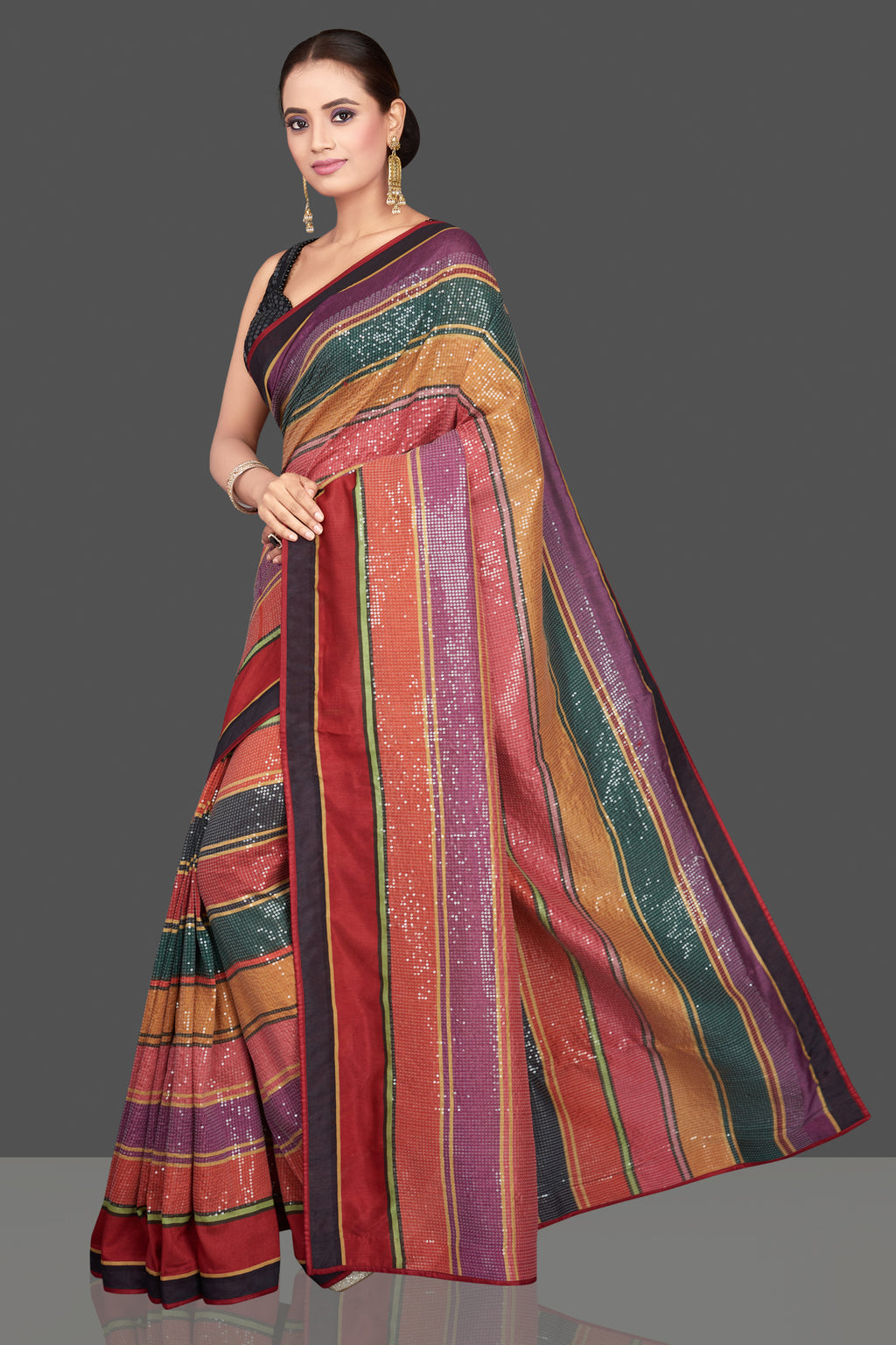 Shop stunning multicolor striped sequin georgette sari online in USA with black saree blouse. Look glamorous at parties and weddings in stunning designer sarees, embroidered sareees, fancy sarees, Bollywood sarees from Pure Elegance Indian saree store in USA.-full view