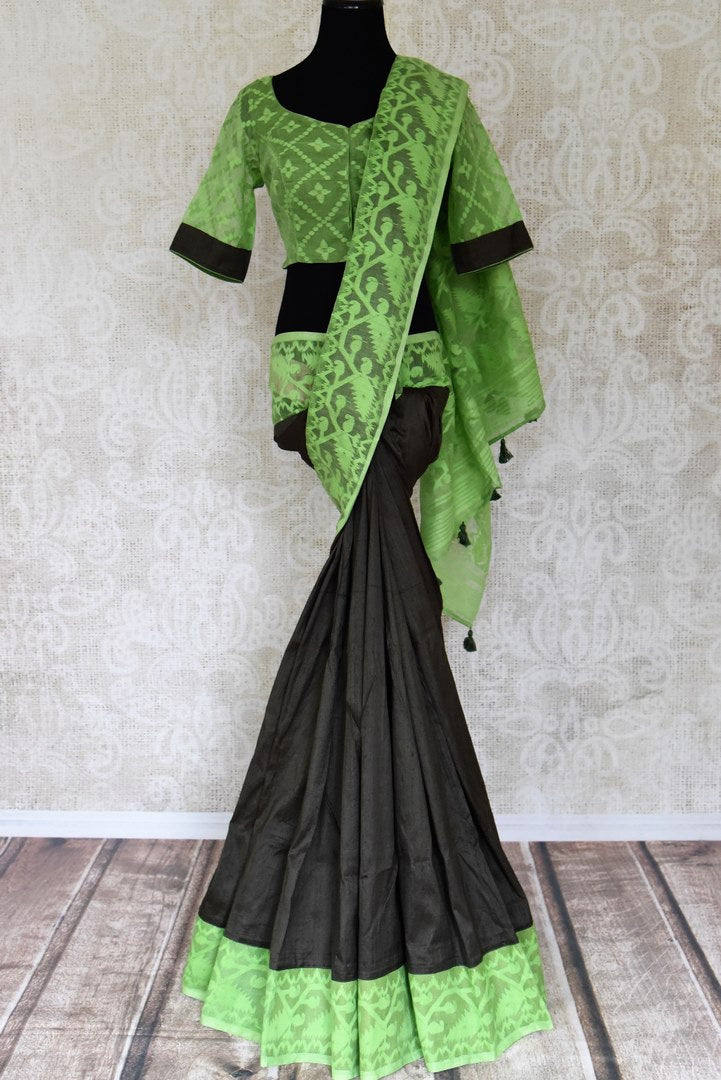 Shop gorgeous black raw silk sari online in USA with green Jamdani border and saree blouse. Shop beautiful handwoven saris, chanderi sarees, Maheshwari sarees, pure silk sarees, Banarasi sarees online in USA from Pure Elegance Indian fashion store.-full view