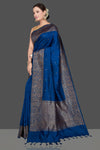 Buy stunning dark blue tussar Banarasi saree online in USA with antique zari buta border. Go for stunning Indian designer sarees, georgette sarees, handwoven saris, embroidered sarees for festive occasions and weddings from Pure Elegance Indian clothing store in USA.-full view