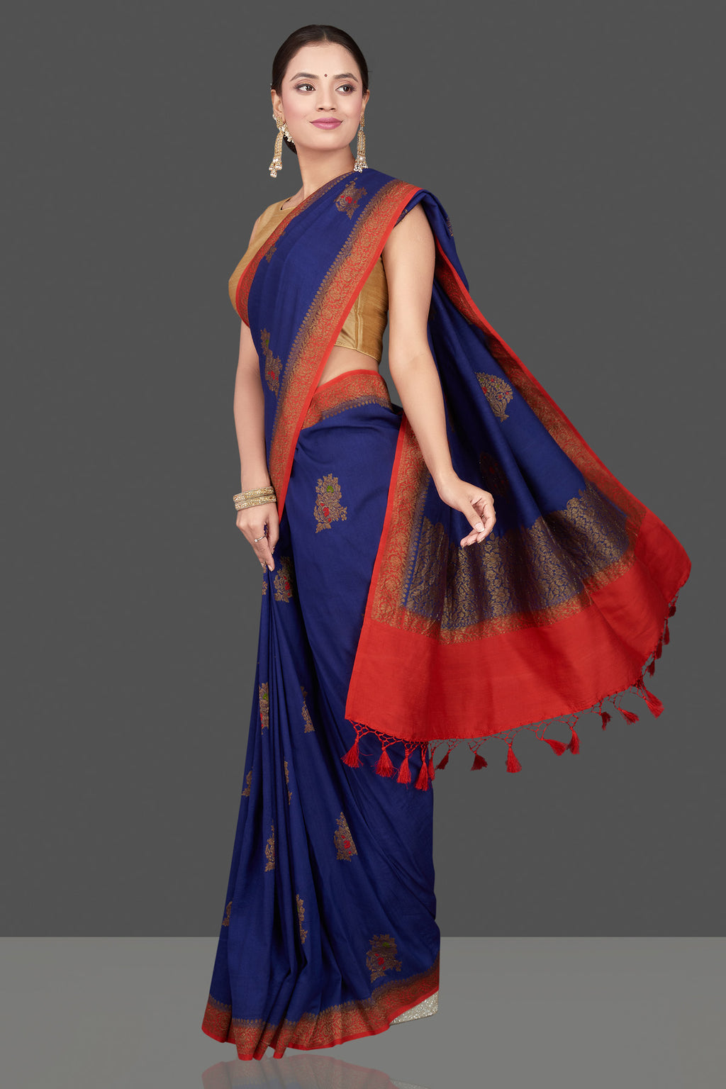 Buy beautiful dark blue Muga Banarasi saree online in USA with red antique zari border. Get ready for festive occasions and weddings in tasteful designer sarees, Banarasi sarees, handwoven sarees from Pure Elegance Indian clothing store in USA.-full view