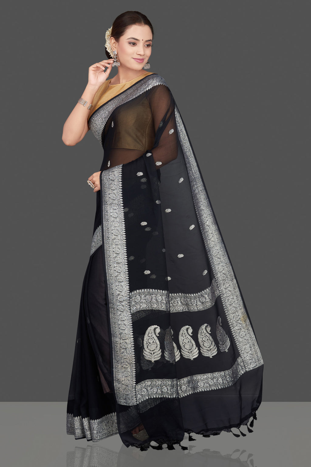 Buy black chiffon georgette saree online in USA with silver zari border. Go for stunning Indian designer sarees, georgette sarees, handwoven saris, embroidered sarees for festive occasions and weddings from Pure Elegance Indian clothing store in USA.-full view