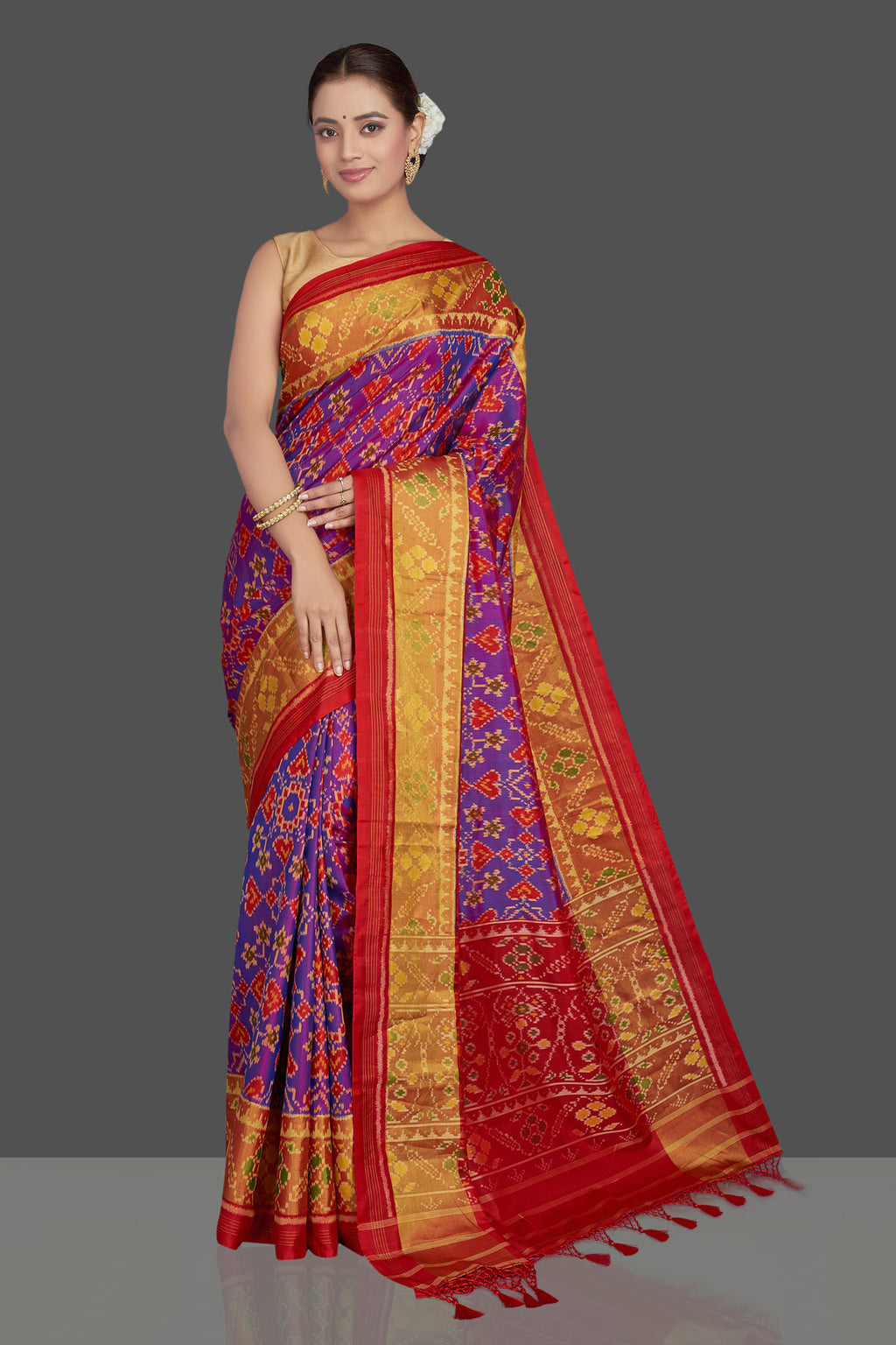 Shop stunning purple ikkat Patola silk sari online in USA with red golden zari border. Make a fashion statement on weddings and special occasions in stunning silk sarees, Patola sarees, handwoven silk sarees, designer saris from Pure Elegance Indian clothing store in USA.-full view