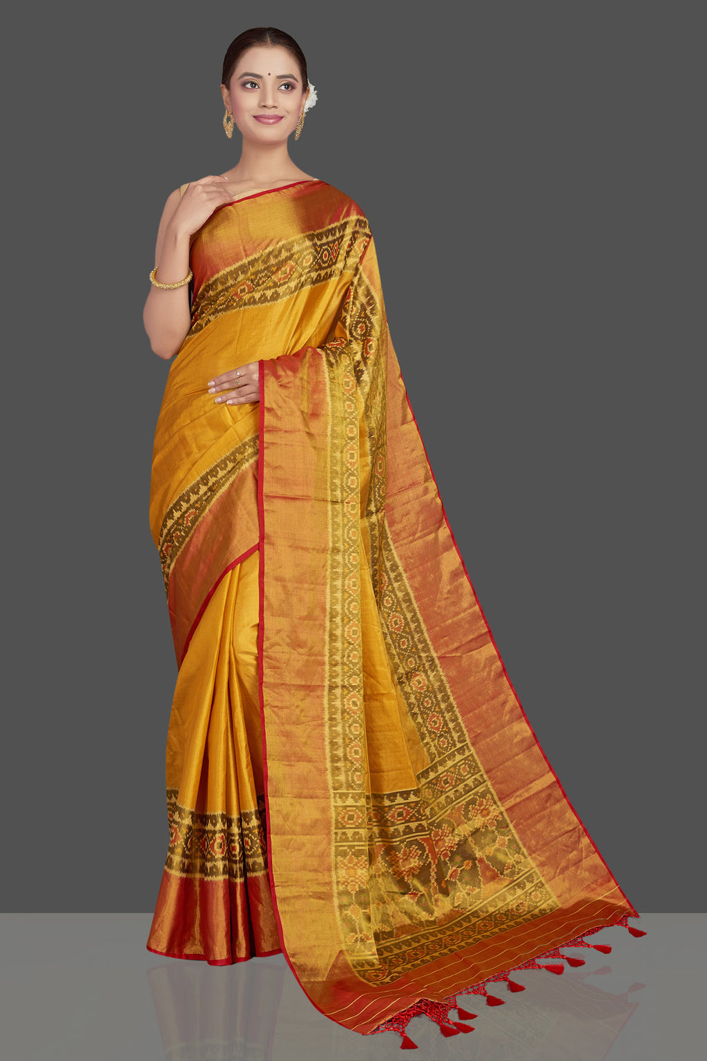 Buy stunning yellow ikkat Patola silk sari online in USA with red golden zari border. Make a fashion statement on weddings and special occasions in stunning silk sarees, Patola sarees, handwoven silk sarees, designer saris from Pure Elegance Indian clothing store in USA.-full view