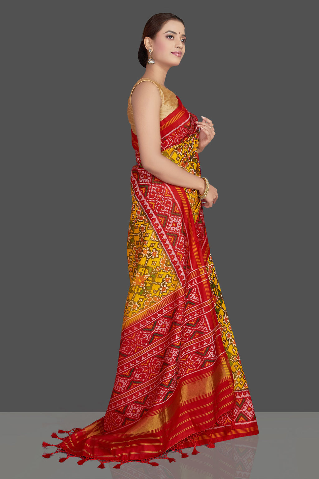 Buy beautiful yellow ikkat Patola silk saree online in USA with red ikkat border. Make a fashion statement on weddings and special occasions in stunning silk sarees, Patola sarees, handwoven silk sarees, designer saris from Pure Elegance Indian clothing store in USA.-side