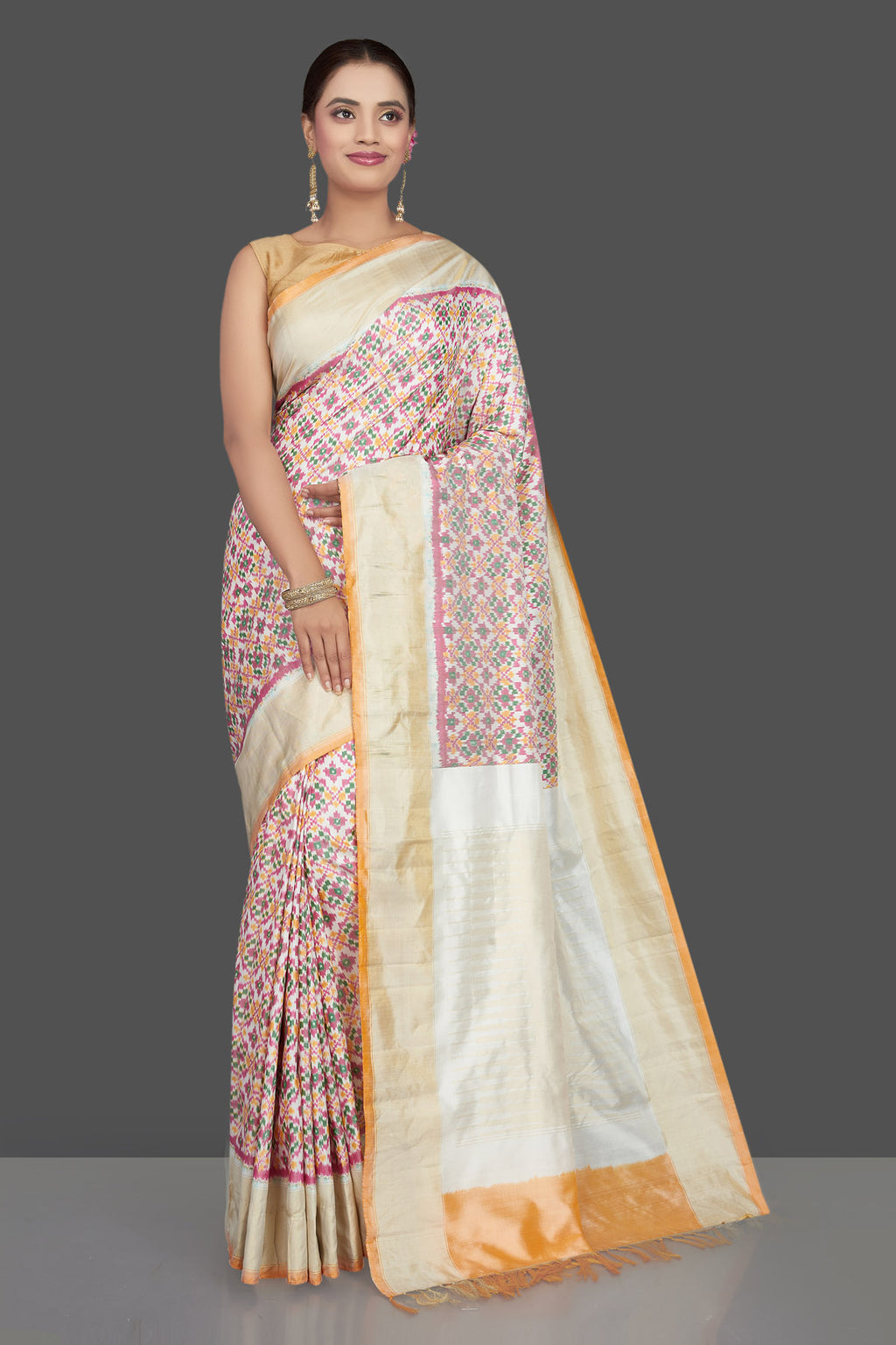 Buy beautiful cream ikkat silk saree online in USA with golden zari border. Get ready for festive occasions in exclusive silk sarees, ikkat saris, Kanchipuram silk sarees, designer sarees from Pure Elegance Indian sarees store in USA.-full view