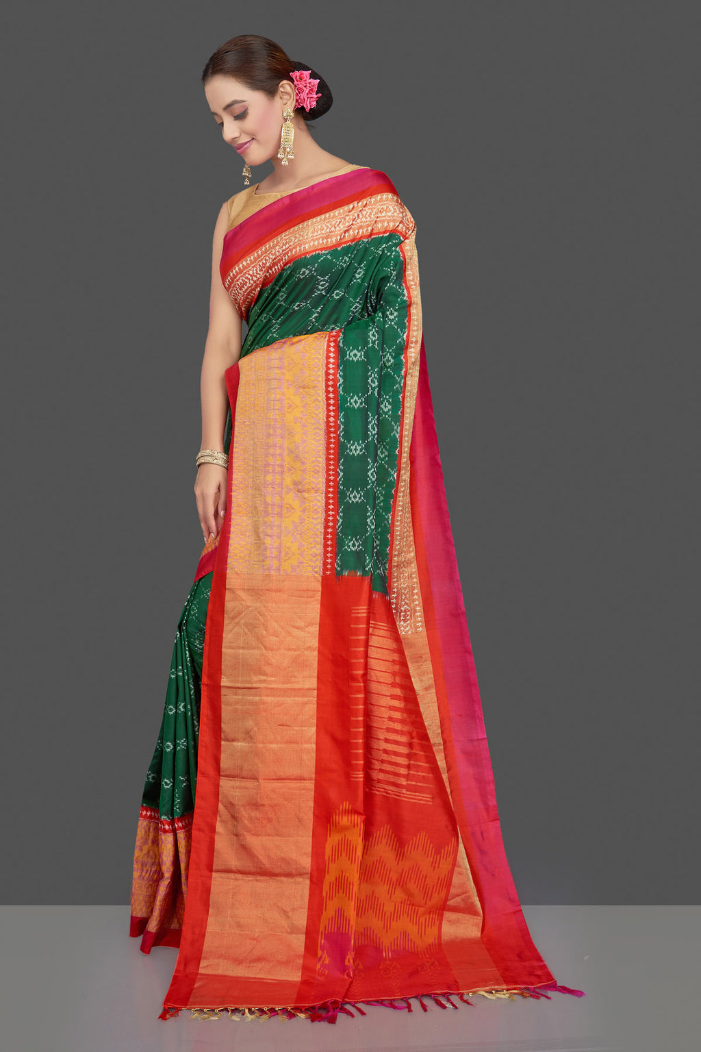 Buy stunning green ikkat silk sari online in USA with pink border. Get ready for festive occasions in exclusive silk sarees, ikkat saris, Kanchipuram silk sarees, designer sarees from Pure Elegance Indian sarees store in USA.-full view