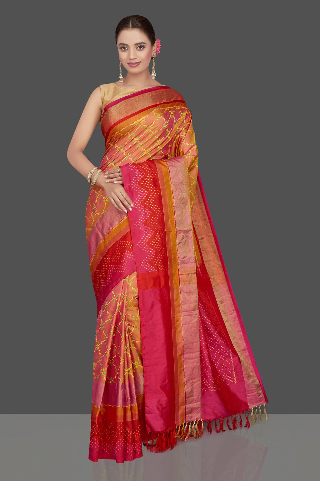 Buy beautiful dusty pink ikkat silk sari online in USA with pink and red border. Get ready for festive occasions in exclusive silk sarees, ikkat saris, Kanchipuram silk sarees, designer sarees from Pure Elegance Indian sarees store in USA.-full view