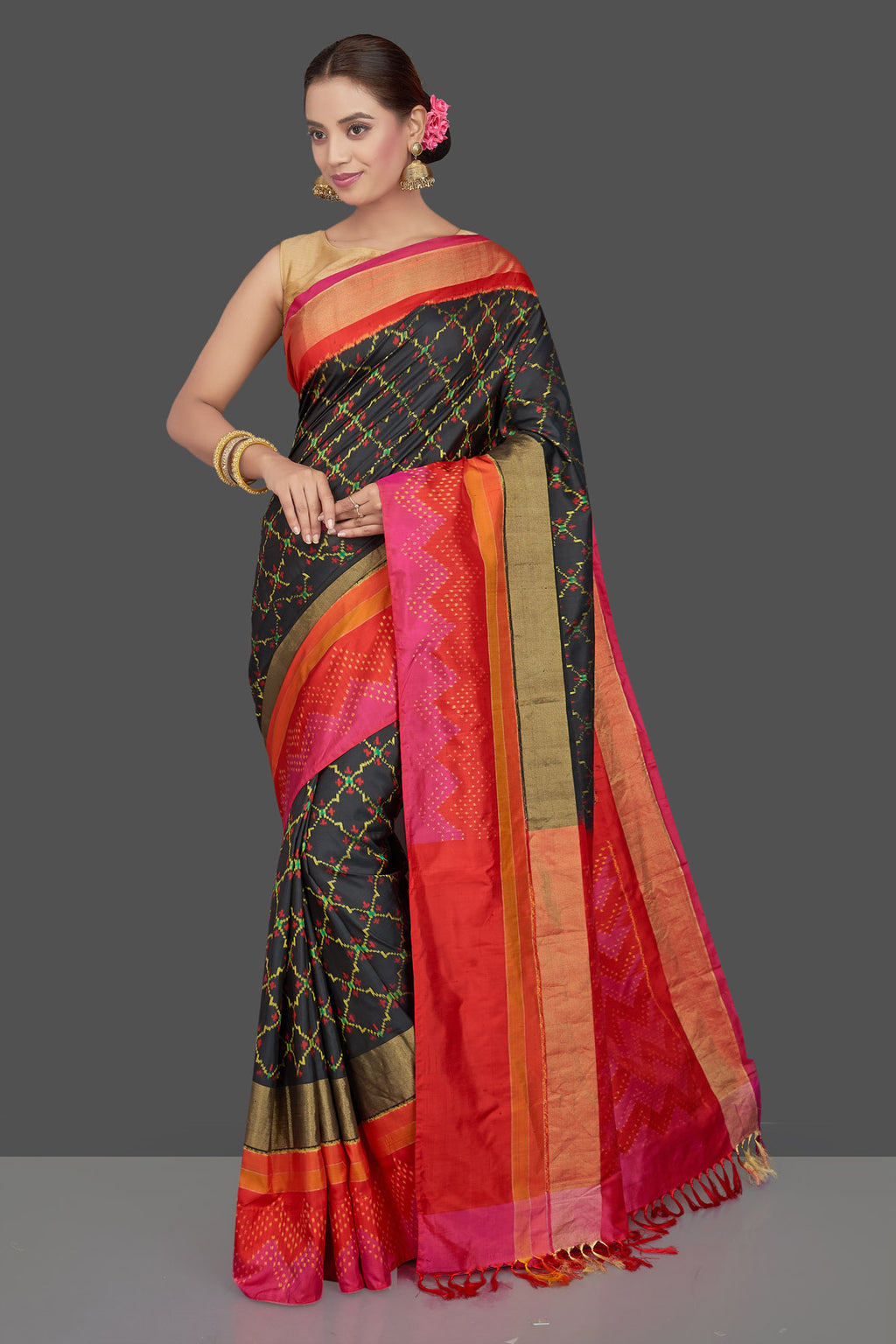 Shop stunning black ikkat silk sari online in USA with pink and red border. Get ready for festive occasions in exclusive silk sarees, ikkat saris, Kanchipuram silk saris, designer sarees from Pure Elegance Indian sarees store in USA.-full view