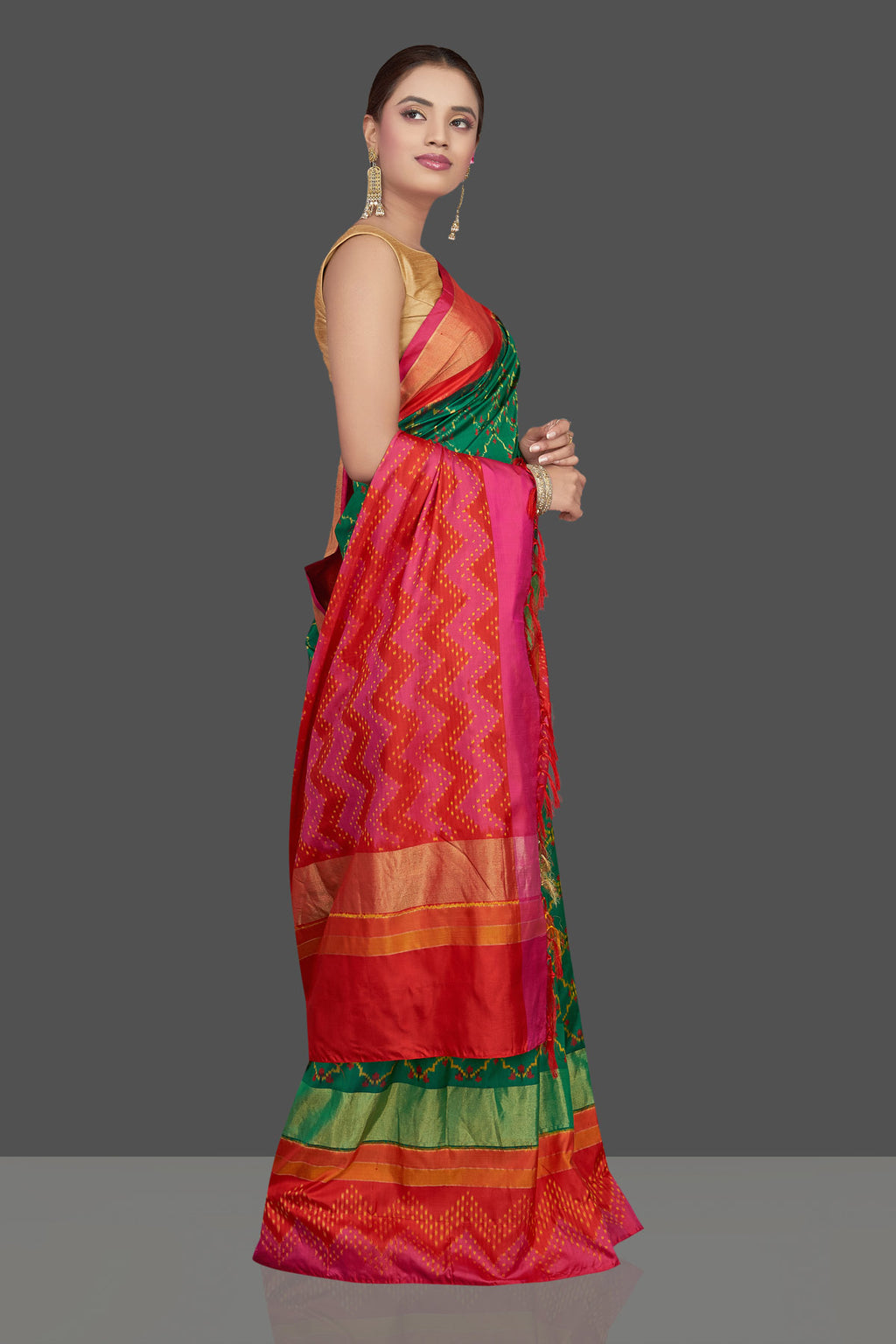 Shop beautiful green ikkat silk sari online in USA with red and pink border. Get ready for festive occasions in exclusive silk sarees, ikkat saris, Kanchipuram silk saris, designer sarees from Pure Elegance Indian sarees store in USA.-side