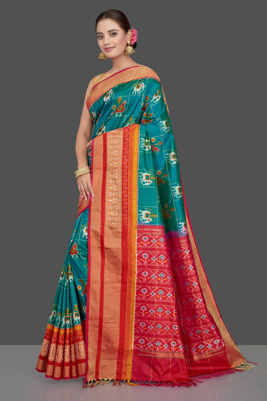 Shop stunning green silk ikkat sari online in USA with red ikkat pallu. Get ready for festive occasions in exclusive silk sarees, ikkat saris, Kanchipuram silk saris, designer sarees from Pure Elegance Indian sarees store in USA.-full view