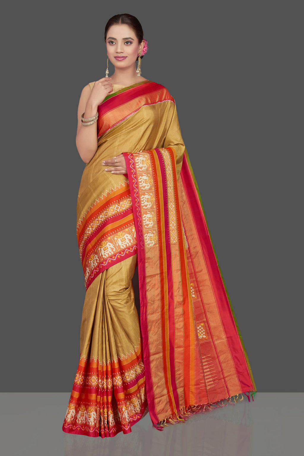 Shop beautiful beige ikkat silk saree online in USA with red and orange border. Get ready for festive occasions in exclusive silk sarees, ikkat saris, Kanchipuram silk saris, designer sarees from Pure Elegance Indian sarees store in USA.-full view