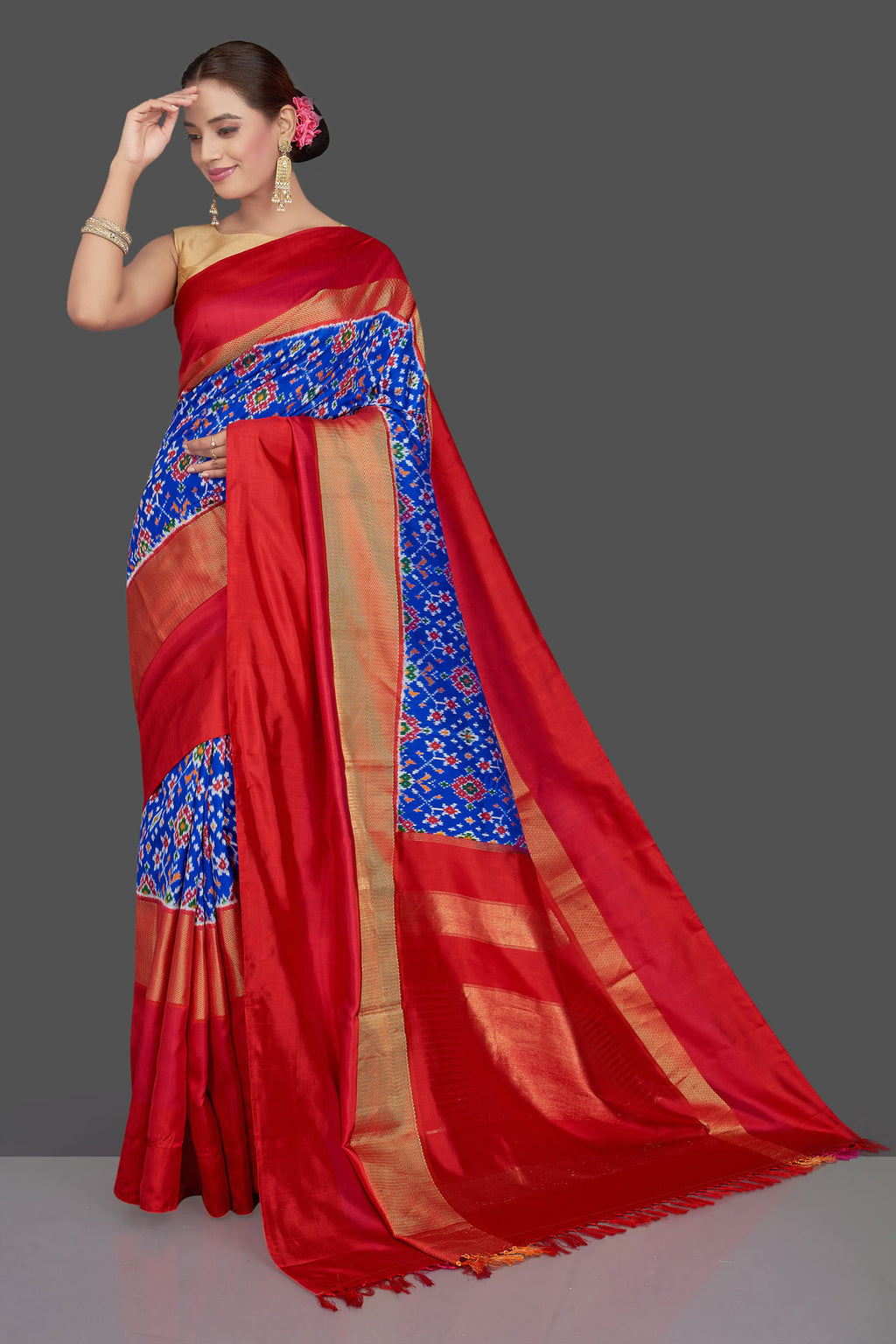 Buy stunning blue ikkat silk saree online in USA with red and golden border. Get ready for festive occasions in exclusive silk sarees, ikkat sarees, Kanchipuram silk saris, designer sarees from Pure Elegance Indian sarees store in USA.-full view