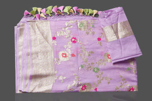 Shop beautiful lavender georgette sari online in USA with silver zari floral jaal. Make an impeccable ethnic fashion statement on festive occasions with traditional Indian sarees, pure silk sarees, designer sarees, handwoven saris, Banarasi sarees from Pure Elegance Indian saree store in USA.-blouse