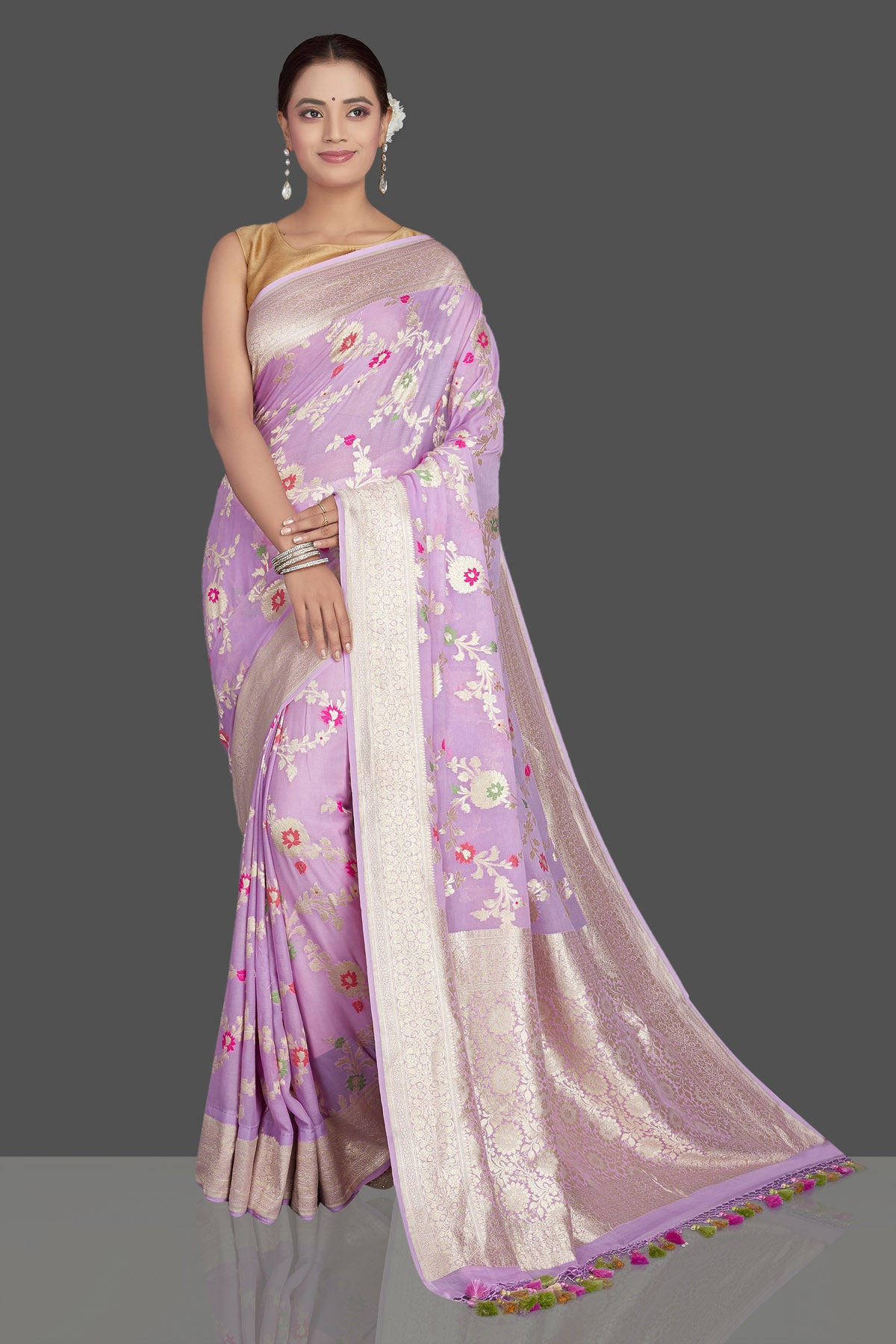 Shop beautiful lavender georgette sari online in USA with silver zari floral jaal. Make an impeccable ethnic fashion statement on festive occasions with traditional Indian sarees, pure silk sarees, designer sarees, handwoven saris, Banarasi sarees from Pure Elegance Indian saree store in USA.-full view