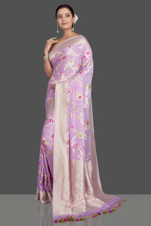 Shop beautiful lavender georgette sari online in USA with silver zari floral jaal. Make an impeccable ethnic fashion statement on festive occasions with traditional Indian sarees, pure silk sarees, designer sarees, handwoven saris, Banarasi sarees from Pure Elegance Indian saree store in USA.-side