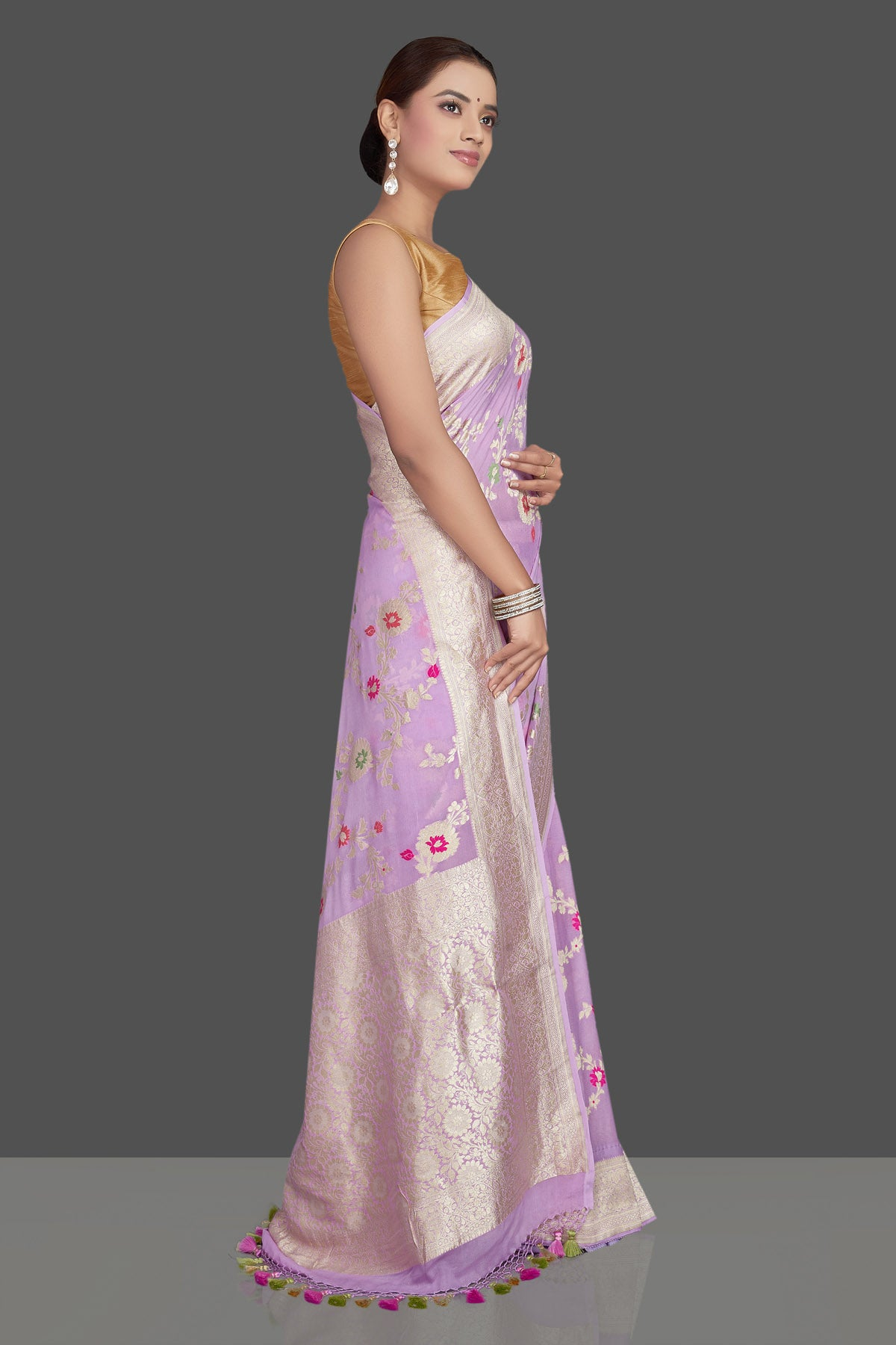 Shop beautiful lavender georgette sari online in USA with silver zari floral jaal. Make an impeccable ethnic fashion statement on festive occasions with traditional Indian sarees, pure silk sarees, designer sarees, handwoven saris, Banarasi sarees from Pure Elegance Indian saree store in USA.-right