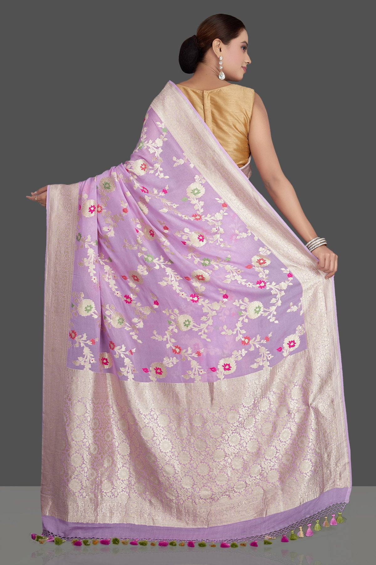 Shop beautiful lavender georgette sari online in USA with silver zari floral jaal. Make an impeccable ethnic fashion statement on festive occasions with traditional Indian sarees, pure silk sarees, designer sarees, handwoven saris, Banarasi sarees from Pure Elegance Indian saree store in USA.-back