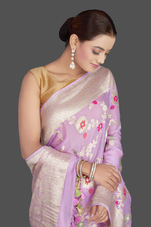 Shop beautiful lavender georgette sari online in USA with silver zari floral jaal. Make an impeccable ethnic fashion statement on festive occasions with traditional Indian sarees, pure silk sarees, designer sarees, handwoven saris, Banarasi sarees from Pure Elegance Indian saree store in USA.-closeup