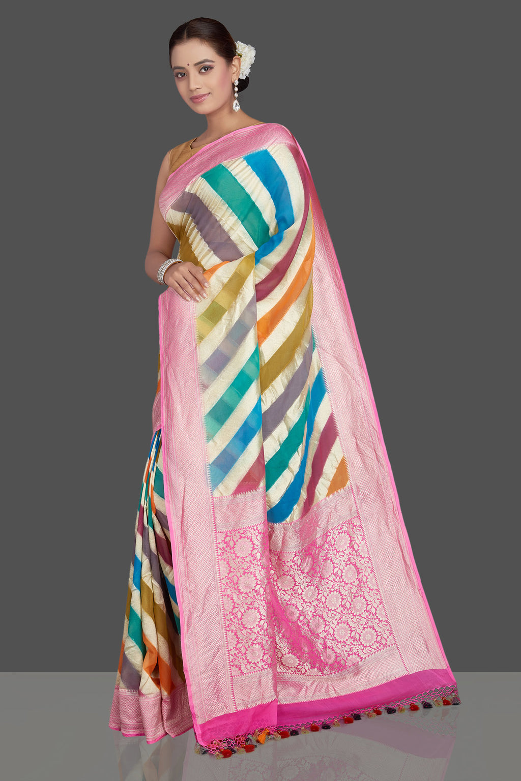 Buy beautiful multicolor stripes tissue sari online in USA with pink zari border. Make an impeccable ethnic fashion statement on festive occasions with traditional Indian sarees, pure silk sarees, designer sarees, handwoven saris, Banarasi sarees from Pure Elegance Indian saree store in USA.-full view