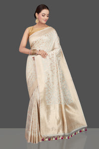 Buy beautiful off-white Katan silk sari online in USA with zari and minakari work. Make an impeccable ethnic fashion statement on festive occasions with traditional Indian sarees, pure silk sarees, designer sarees, handwoven sarees, Banarasi sarees from Pure Elegance Indian saree store in USA.-full view