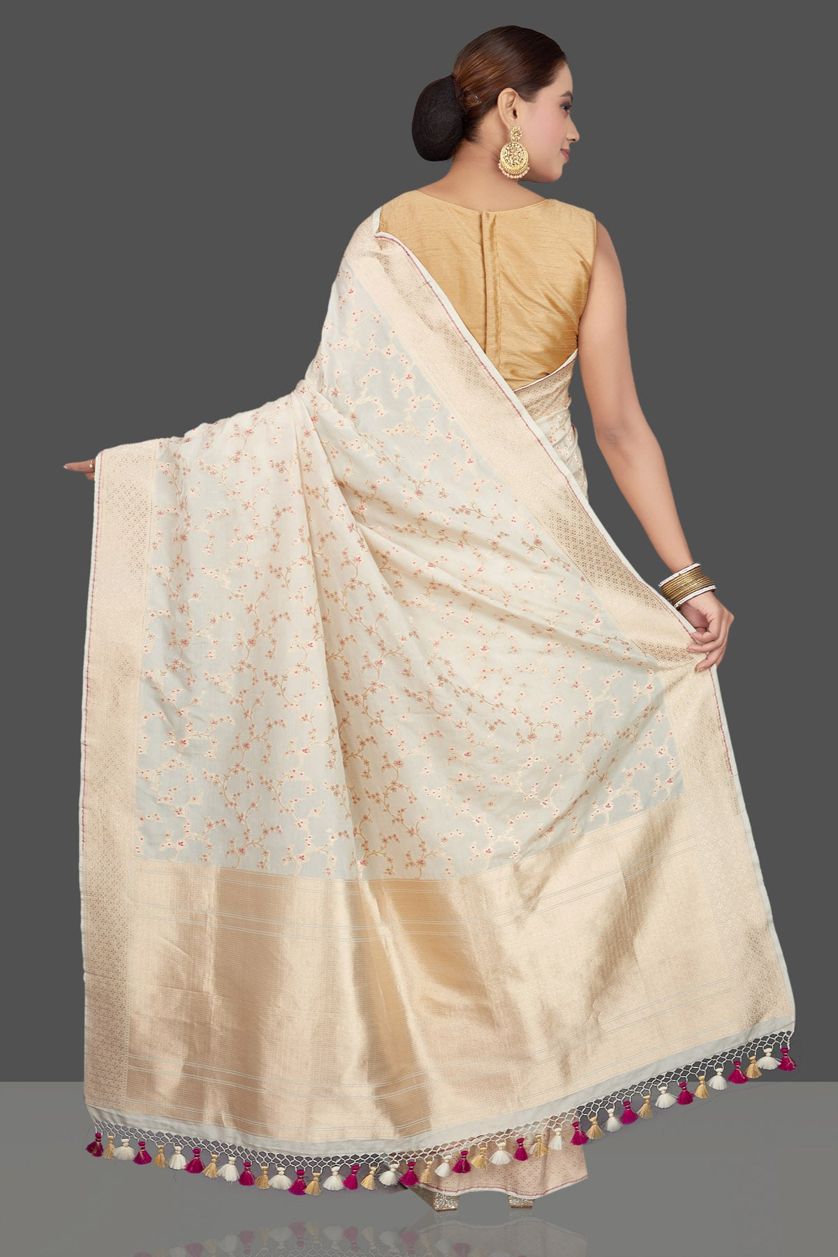Buy beautiful off-white Katan silk sari online in USA with zari and minakari work. Make an impeccable ethnic fashion statement on festive occasions with traditional Indian sarees, pure silk sarees, designer sarees, handwoven sarees, Banarasi sarees from Pure Elegance Indian saree store in USA.-back