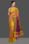 Shop stunning peach khaddi sari online in USA with jacquard weave pallu. Look gorgeous on special occasions with exquisite Indian sarees, handwoven sarees, Banarasi sarees, pure silk sarees from Pure Elegance Indian saree store in USA.-full view