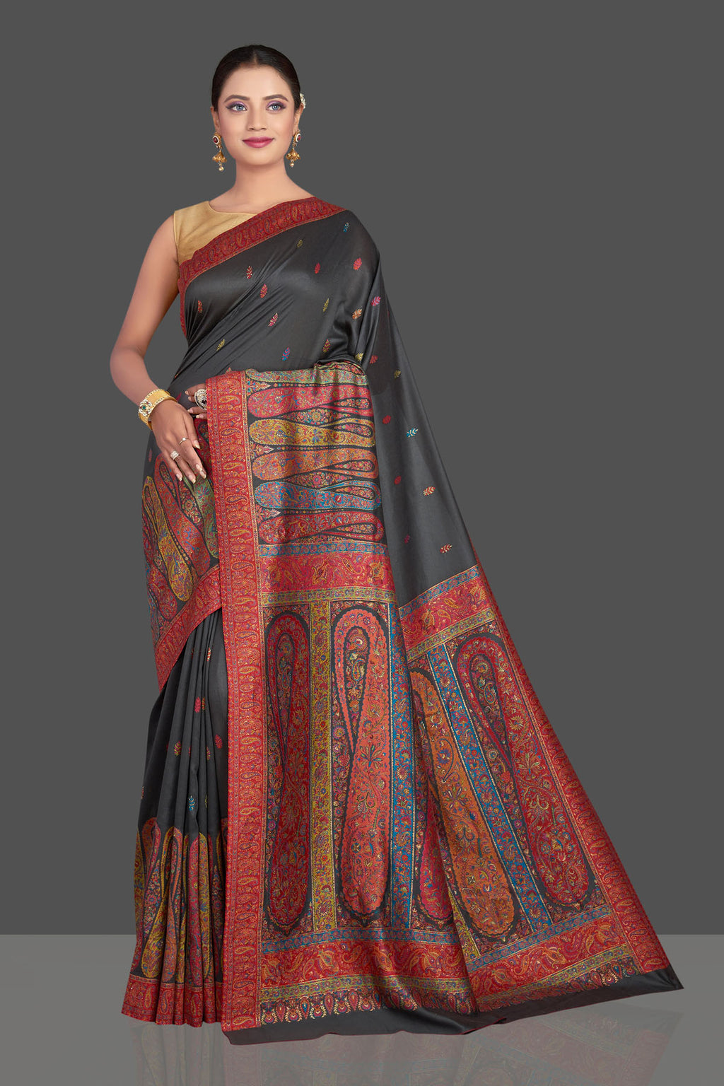 Shop stunning black tussar silk sari online in USA with multicolor Kani embroidery. Make your presence felt on special occasions in beautiful embroidered sarees, handwoven sarees, pure silk saris, tussar sarees from Pure Elegance Indian saree store in USA.-full view