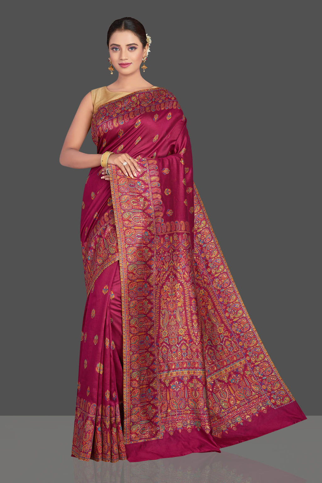 Shop beautiful magenta tussar silk sari online in USA with Kani embroidery. Make your presence felt on special occasions in beautiful embroidered sarees, handwoven sarees, pure silk saris, tussar sarees from Pure Elegance Indian saree store in USA.-full view