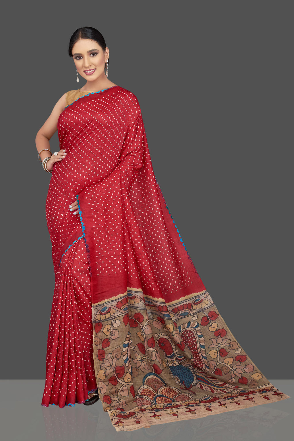 Shop beautiful red Bandhani print gajji silk sari online in USA with beige Kalamkari pallu. Make your presence felt on weddings and special occasions in beautiful Kalamkari sarees, pure silk sarees, printed sarees from Pure Elegance Indian store in USA.-full view