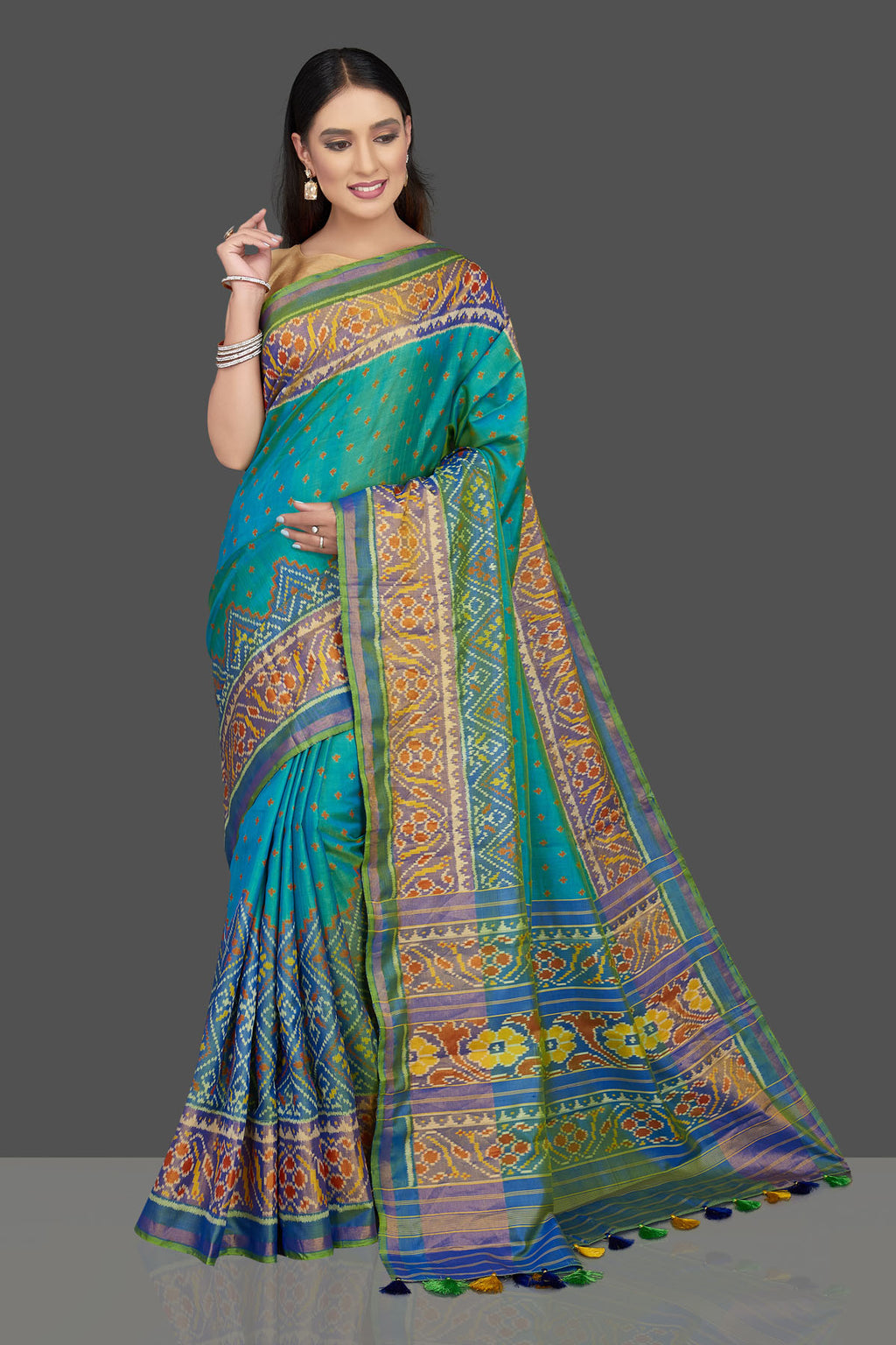Shop stunning greenish blue Patola silk saree online in USA. Radiate elegance at weddings and special occasions with stunning linen sarees, handwoven sarees, pure silk sarees from Pure Elegance Indian fashion store in USA.-full view