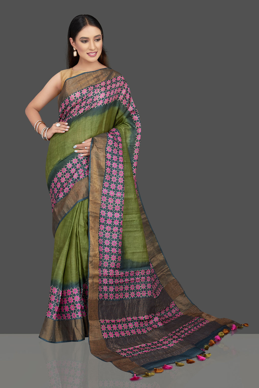Buy gorgeous green tussar silk saree online in USA with pink floral print and zari border. Radiate elegance at weddings and special occasions with stunning linen sarees, handwoven sarees, pure silk sarees from Pure Elegance Indian fashion store in USA.-full view