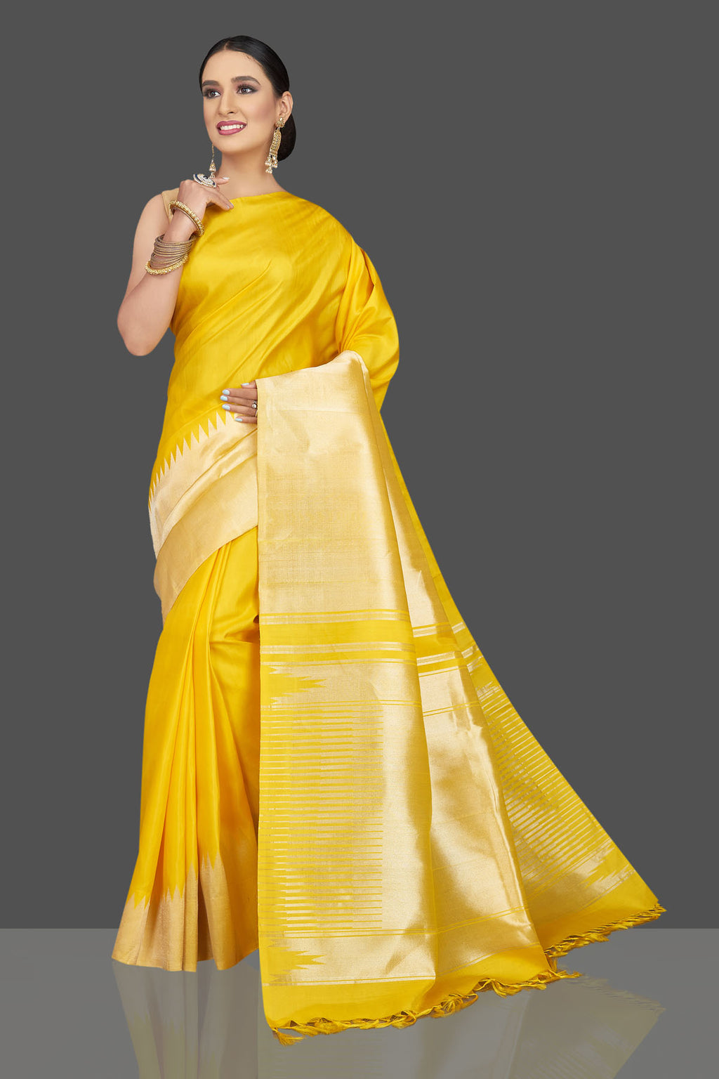 Shop beautiful yellow Kanjivaram sari online in USA with golden zari border. Look beautiful on weddings and special occasions in stunning Kanchipuram saris, pure silk sarees, handwoven saris from Pure Elegance Indian fashion store in USA.-full vie