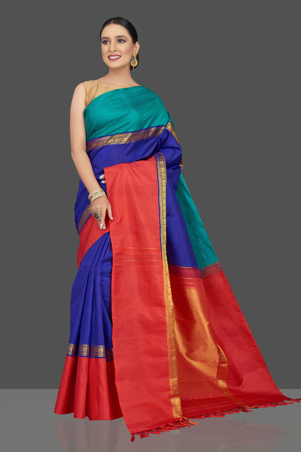 Shop gorgeous blue Kanjivaram saree online in USA with green and red border. Look beautiful on weddings and special occasions in stunning Kanchipuram saris, pure silk sarees, handwoven saris from Pure Elegance Indian fashion store in USA.-full view
