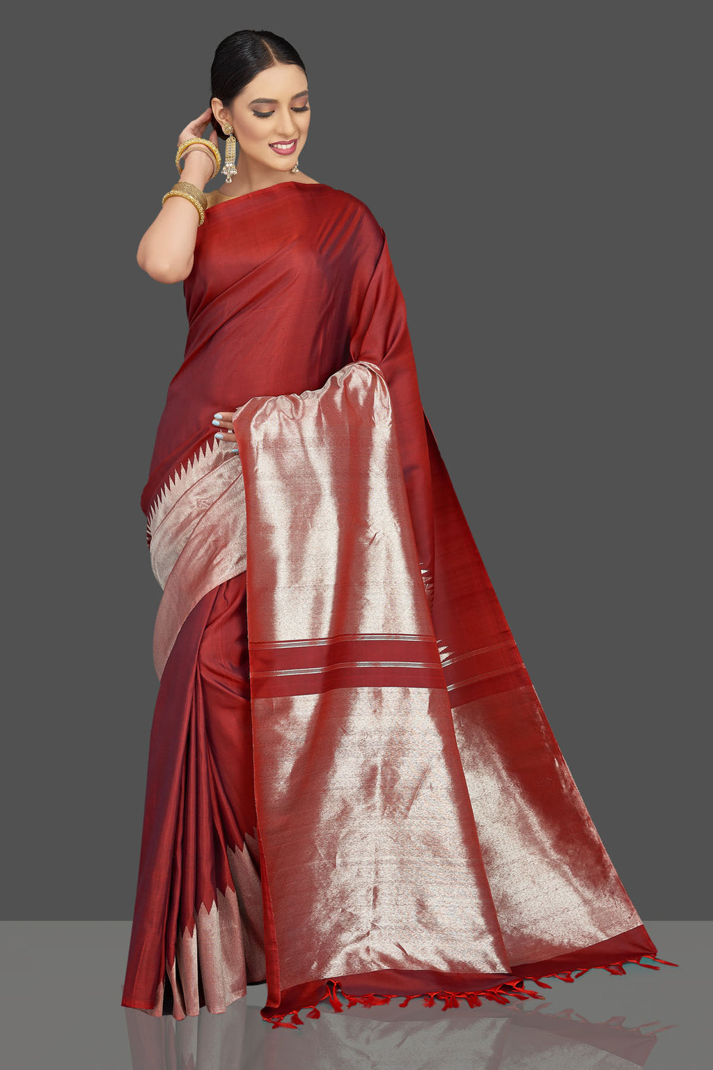 Shop beautiful maroon Kanjivaram sari online in USA with silver zari border. Look beautiful on weddings and special occasions in stunning Kanchipuram saris, pure silk sarees, handwoven saris from Pure Elegance Indian fashion store in USA.-full view