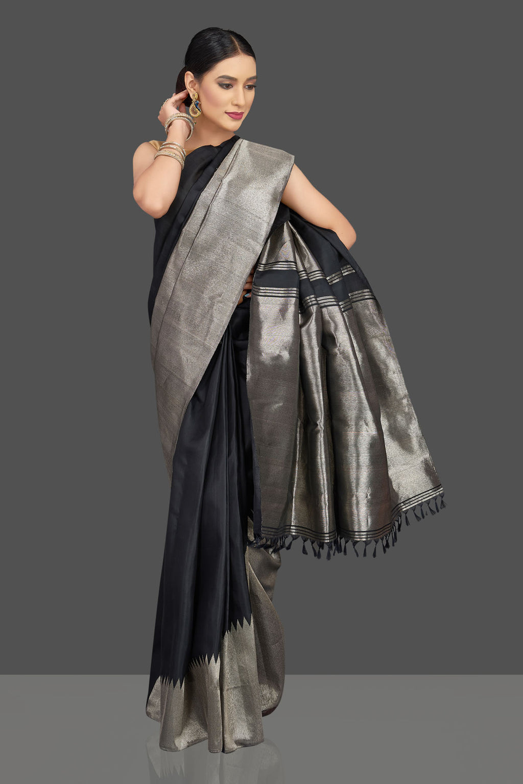 Shop stunning black Kanjivaram saree online in USA with silver zari border. Look beautiful on weddings and special occasions in stunning Kanchipuram saris, pure silk sarees, handwoven saris from Pure Elegance Indian fashion store in USA.-full view