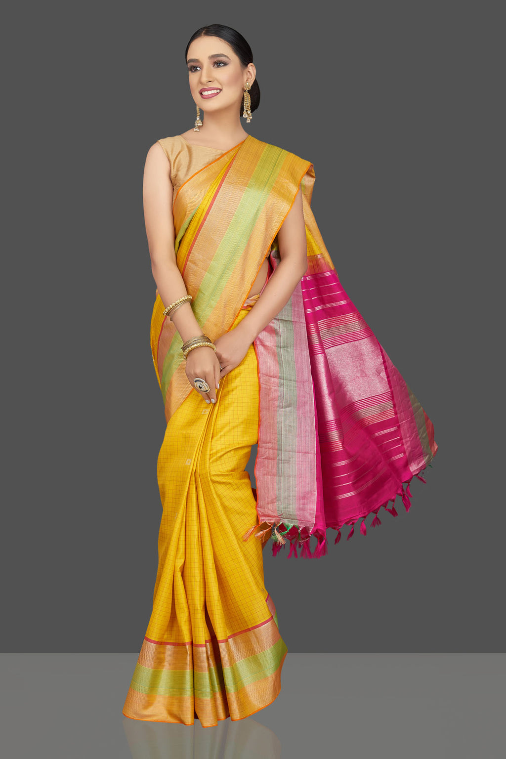 Buy beautiful yellow check Kanjivaram saree online in USA with pink zari pallu. Look beautiful on weddings and special occasions in stunning Kanchipuram saris, pure silk sarees, handwoven saris from Pure Elegance Indian fashion store in USA.-full view