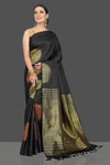 Shop stunning black Kanjivaram sari online in USA with golden and copper zari motifs. Look beautiful on weddings and special occasions in stunning Kanchipuram saris, pure silk sarees, handwoven saris from Pure Elegance Indian fashion store in USA.-full view